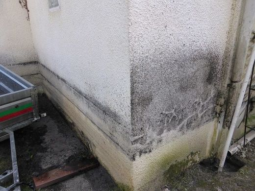 Polluted house wall