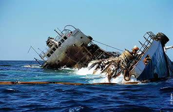 The Jessica wreck surrounded with antipollution booms