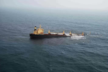 Aerial view of the fuel oil leaking from the sinking Rak Carrier.