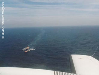 Aerial view of a ship and its wake