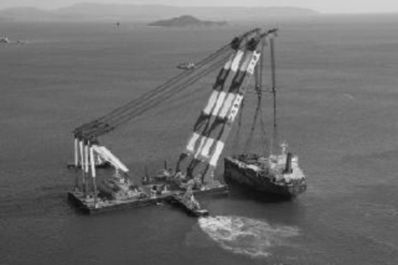 Salvaging the Co-op Venture remains with a crane ship
