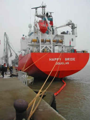The Happy Bride alongside the quay surrounded by a boom